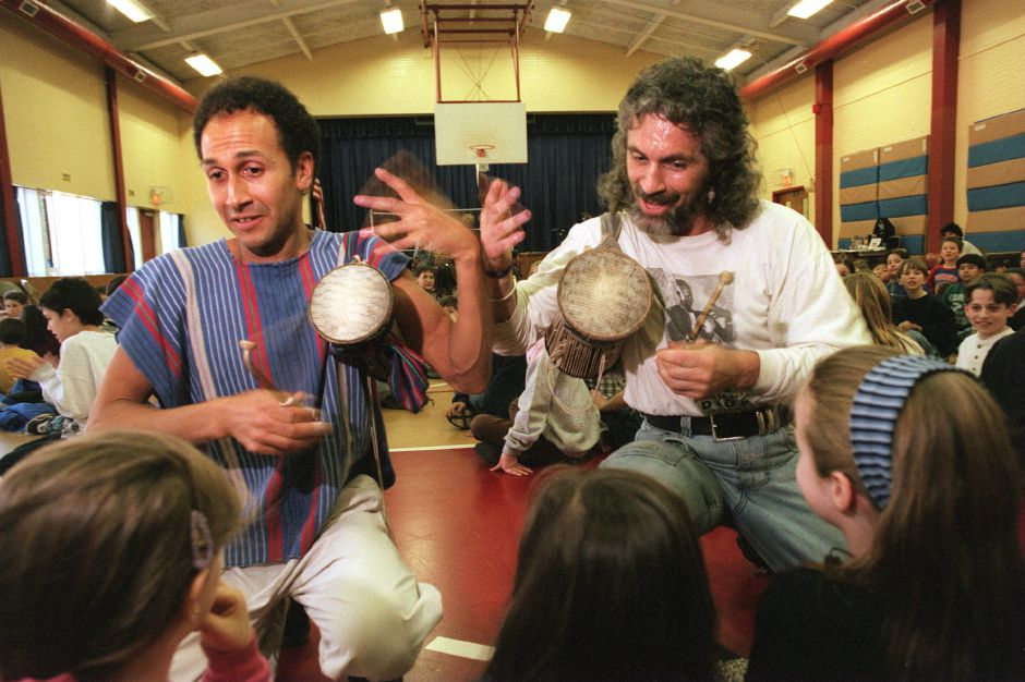 RJ file photo - Steve Leicach, left, and Tony Vacca of Amherst, Mass-based World Rhythm bring their drum beat to students during their rhythm workshop at Parker Farms School in Wallingford Feb. 11, 1999.