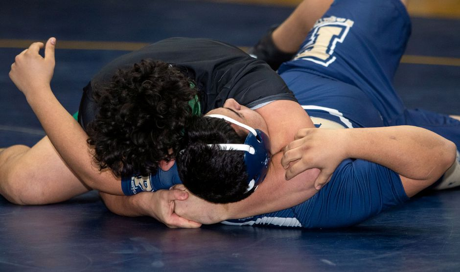 Platt's Carlos Montes wrestles Maloney's Darel Rivera in the 220 lbs weight class at Platt High School on Wednesday, February 12, 2020. Aaron Flaum, Record-Journal