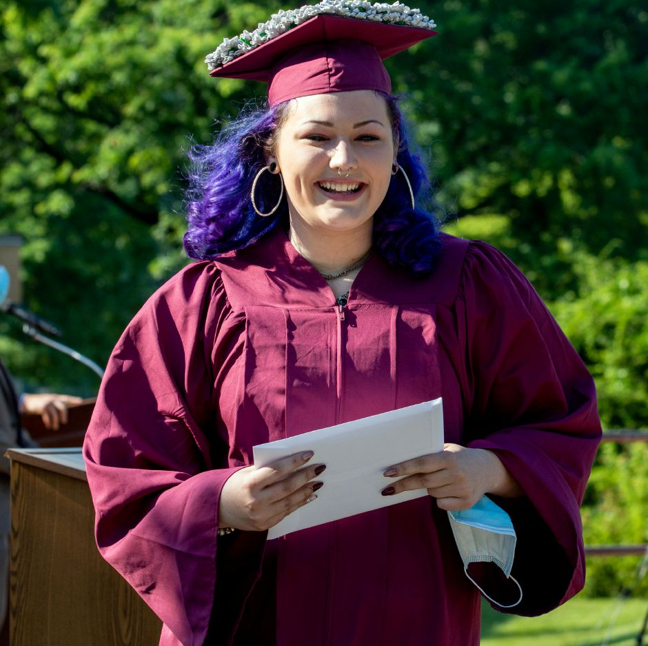Sheehan graduate Kaytlynn Lastinger after receives her diploma on Tuesday, June 23, 2020, during a drive up graduation at the school. Aaron Flaum. Record-Journal