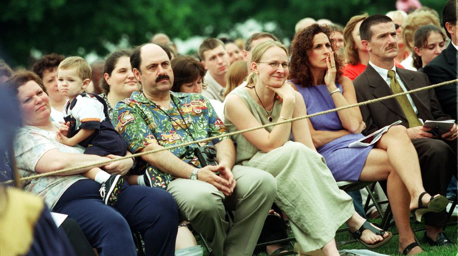 Family and friends watch the Platt High School graduation Thurs., June 15, 2000 in front of the school.
