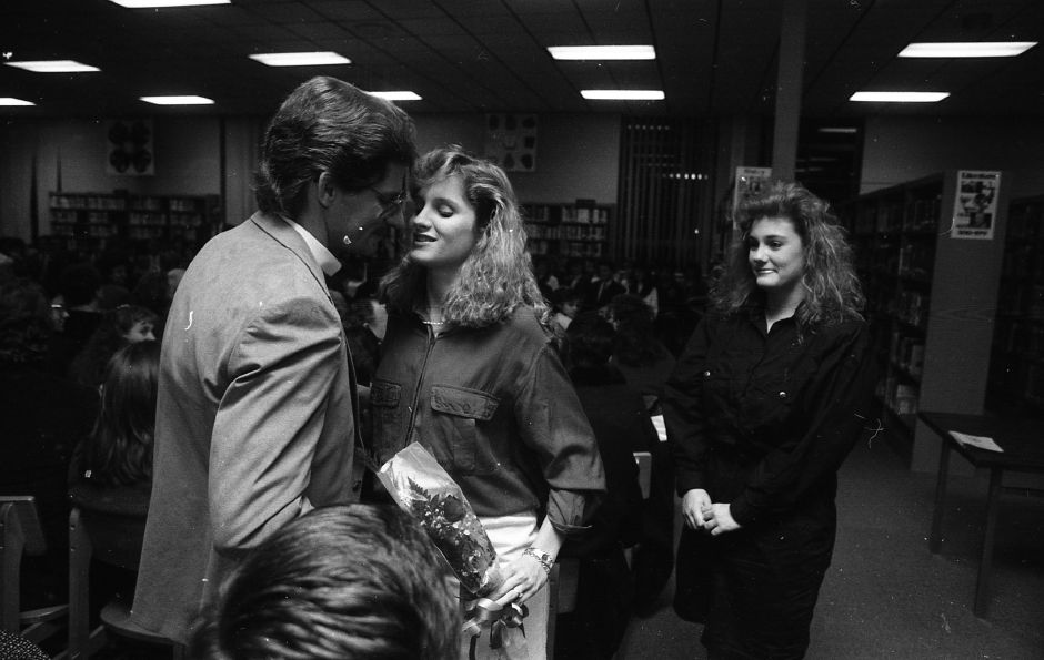 RJ file photo - Erin Mahoney, middle, is congratulated by her father Thomas Mahoney during the National Honor Society induction ceremony for 18 Sheehan High School students March 17, 1989.