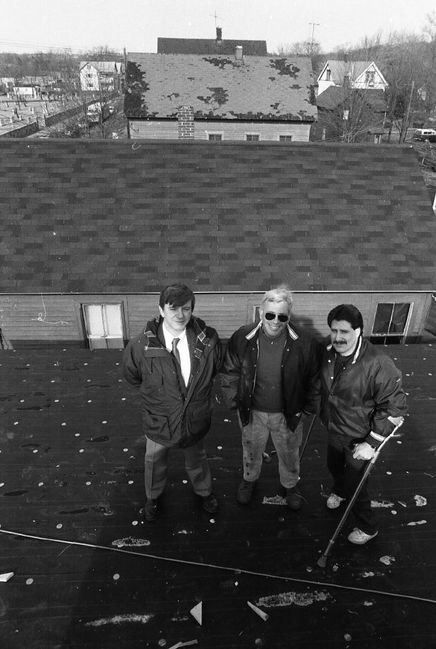 RJ file photo - Architect Samuel Sergeant, left, and developers Michael Cassello and Michael Cassello Jr. are working on a project to restore a group of late 1800s buildings along Route 5 in Wallingford, Feb. 1989. In the next 10 years, they say there will be more retoration projects in town.