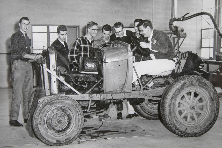 This  photo shows Lyman Hall High School agricultural students gathered around a tractor. The photo is one of many in the first edition of the Future Farmers of America Official Scrap Book Lyman Hall Chapter.