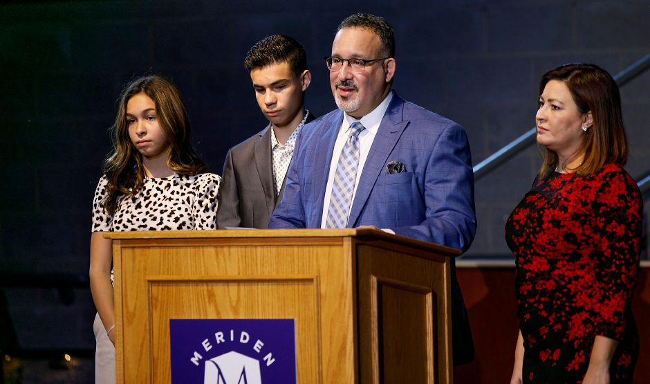 Miguel Cardona, President-elect Joe Biden's choice for the next U.S. secretary of education, speaks next to his wife, Marissa, and his children, Miguel Jr., 16, and Celine, 14,  during a livestream event Monday at Maloney High School. Dave Zajac, Record-Journal
