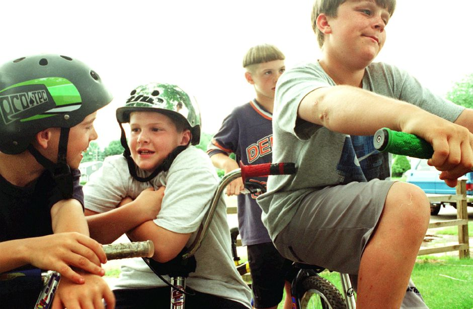 (From left to right) Jordan Koeller, Cristopher Sunbury, Darrell Hotham, and Nick Nedjoika enjoy one of their first days of summer vacation on their BMX bikes Thursday afternoon in their neighborhood, Berkley Court in Southington June 22, 2000.