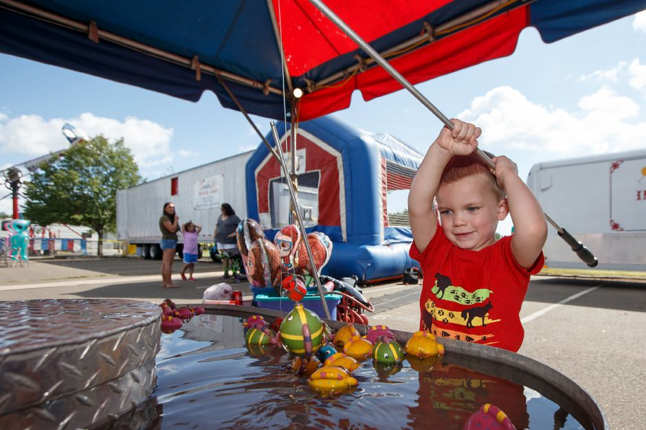 Ethan Tresp 3 of Cheshire tries out the fishing hole Saturday during the Cheshire Fall Festival in Bartlem Park Cheshire September 15, 2018 | Justin Weekes / Special to the Record-Journal