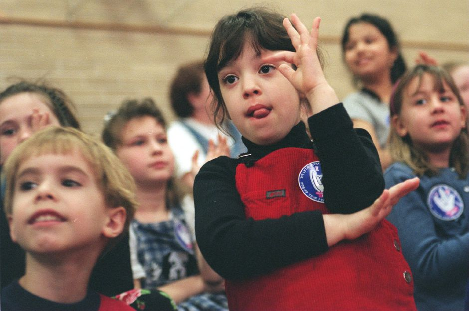 RJ file photo - Mariana Santiago, a second-grader at Moses Y. Beach School in Wallingford, makes the symbol for a tree in American sign language. The Little Theater of the Deaf performed at the school March 4, 1999.