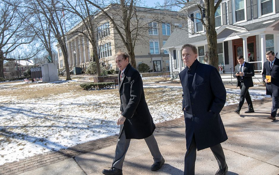 Mayor William W. Dickinson Jr., left, and Gov. Ned Lamont tour the uptown area of Wallingford, Thurs., Feb. 28 2019. Dave Zajac, Record-Journal
