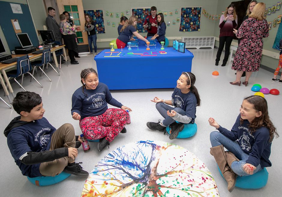 Art Club students, left to right, Luis Baez, 10, Ajalon Delojach, 10, Jazmine Mejico, 10 and Acelynn Timm, 11, gather for a moment of group meditation in The Sage Room, a new mindfulness space at Benjamin Franklin Elementary School in Meriden, Fri., Feb. 21, 2020. The room encourages emotional regulation through the act of play, promotes a relaxing sensory experience and decreases stress and anxiety. Art Club students helped make signs and murals for the room. Dave Zajac, Record-Journal