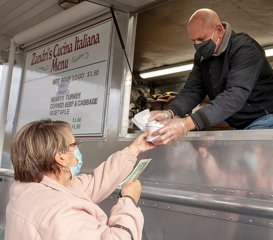 Helper Phil Mazzone, serves up a cup of beef barley soup to Toni Hale, of West Haven, who was on a break from work in Wallingford at the new Zandri
