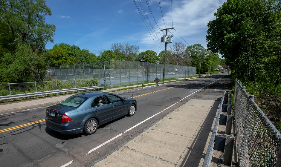 A motorist travels east on Coe Avenue near the end of the Meriden Linear Trail at Platt High School in Meriden, Tues., May 19, 2020. The City of Meriden's Engineering Department will continue the trail along Coe Avenue to the Bradley Avenue Bridge that overlooks Harbor Brook. The extension of the trail should be completed by the end of the summer. Dave Zajac, Record-Journal
