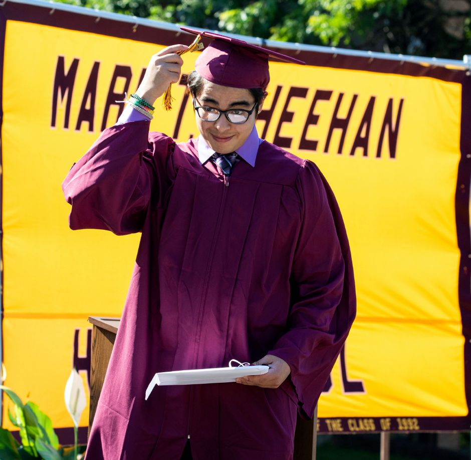 Sheehan graduate Jonathan Calvillo turns his tassel after receiving his diploma Tuesday, June 23, 2020, during a drive up graduation at the school. Aaron Flaum. Record-Journal