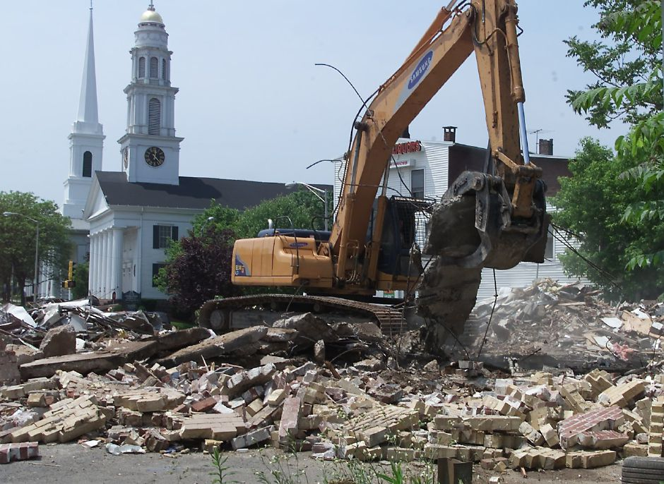 An old gas station at the corner of N. Main Street and Broad Street in Meriden has been torn down June 1, 2000.
