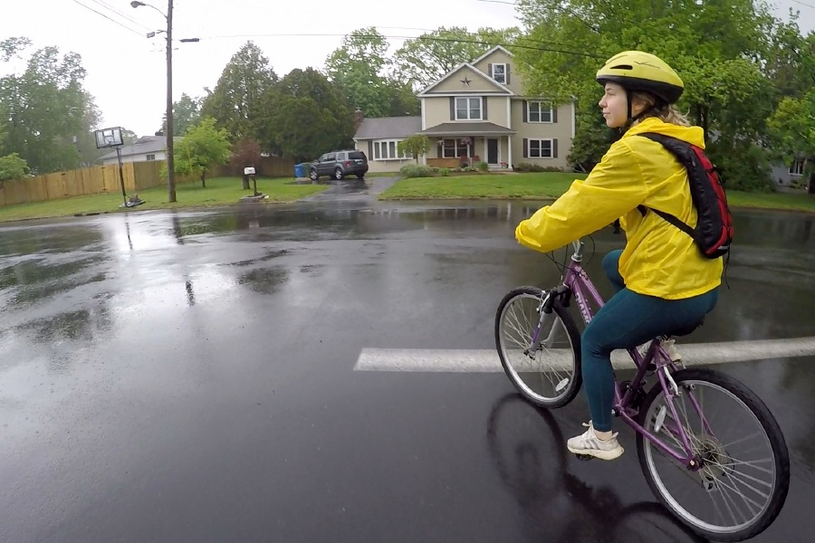 Kristen Dearborn rides her bike in the rain with a fully stocked backpack, items seen below,  and a contingency plan for if conditions become unsafe. Photos by Kristen Dearborn, special to Record-Journal