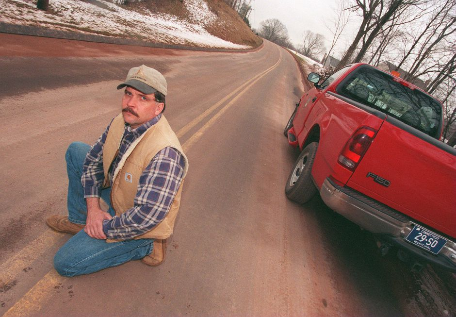 RJ file photo - Steven Wlodkowski has been the highway superintendent for the town of Southington for 15 months Feb. 1999. He is kneeling on East Johnson Street.