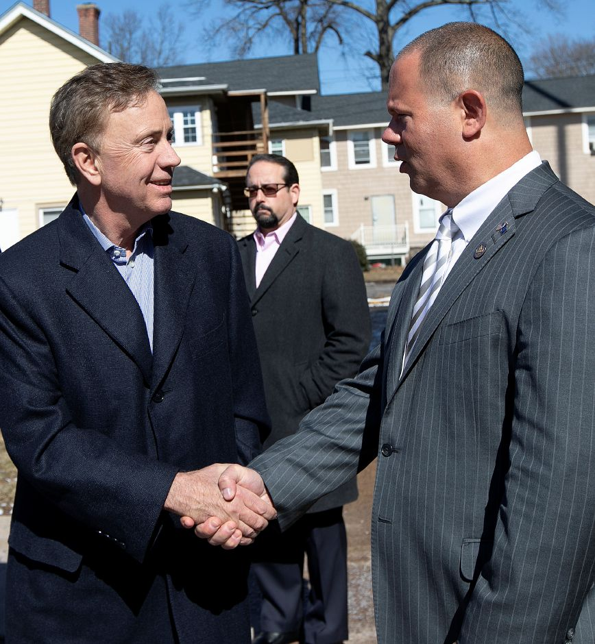 Gov. Ned Lamont, left, shakes hands with Town Councilor Craig Fishbein after a tour of the uptown area of Wallingford, Thurs., Feb. 28 2019. Dave Zajac, Record-Journal