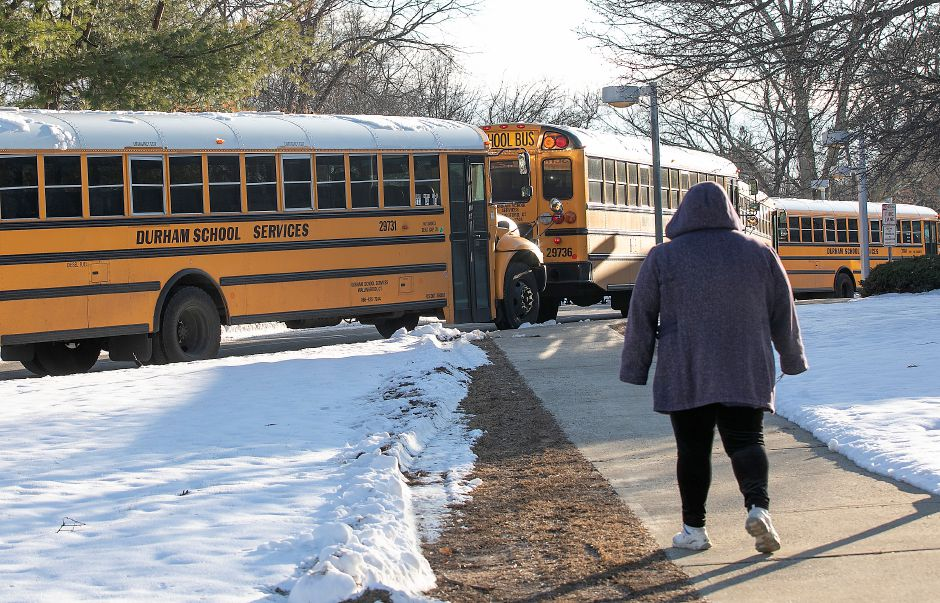 A bus driver heads back to her bus during dismissal at Mary G. Fritz Elementary School in Wallingford, Tues., Jan. 21, 2020. Dave Zajac, Record-Journal