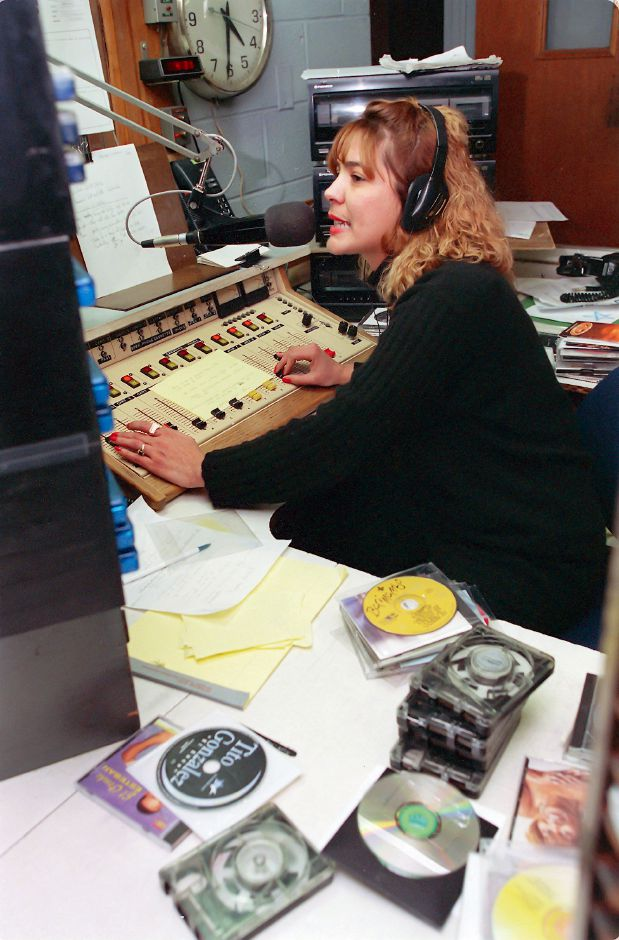 RJ file photo - Luz Lebron broadcasts from the Southington studio of WNTY Feb. 15, 1999. The station may soon be sold to a Rhode Island company.