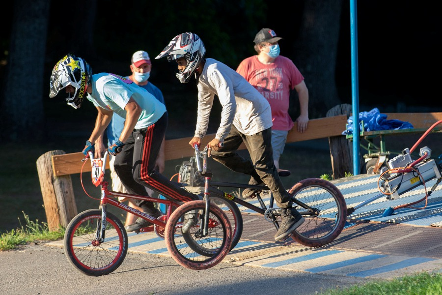 Erik Pulaski, 17, left and Brandon Cabon, 16, both from Meriden, leave the starting gate during a gate practice for BMX racers at the Falcon BMX track at Falcon Field in Meriden on Monday, July 20, 2020. Aaron Flaum, Record-Journal