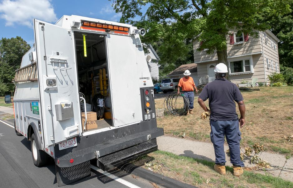 Eversource crews remove wires from the front yard of a residence on Broad Street in Meriden, Fri., Aug. 7, 2020. Dave Zajac, Record-Journal