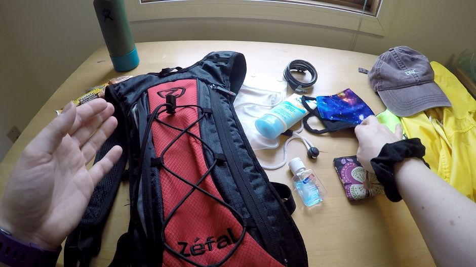 Kristen Dearborn packs a backpack with essential equipment in preparation for a lengthy bike ride. |Kristen Dearborn, Special to Record-Journal