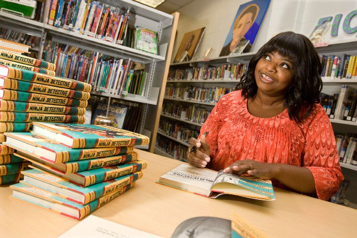 Academy award winning actress and author, Octavia Spencer, center, signs books for students and staff during an end-of-year celebration for students who read a million words throughout the year at Lincoln Middle School, Monday, June 16, 2014. | Dave Zajac / Record-Journal