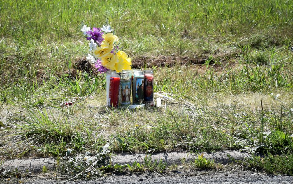 A small vigil on the side of Research Parkway in Meriden marks the general area where local teen Jaylon Nixon was killed in a car crash early Sunday morning. |Bailey Wright, Record-Journal