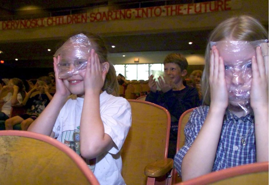 Jennifer Botsacos, 9 and Ashley Morton,9, of Derynoski Elementary School put plastic bags over their eyes to simulate the eye sight of the elderly, Monday June 7, 2000 during a presentation by Alzheimer