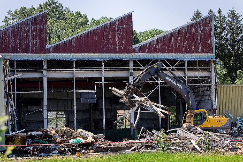 A demolition foreman for Manafort Brothers Inc. uses an excavator to demolish a building at Ideal Forging in Southington on Friday June 3, 2011. Todd Cyr, a laborer for Manafort Brothers said the demolition should take about a month to complete. (Matt Andrew/ Record-Journal)