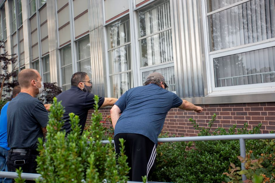 Staff and building management point out bullet holes to Meriden Police Detective John Femia at 500 S. Broad St. Tuesday morning July 7, 2020. | Richie Rathsack, Record-Journal