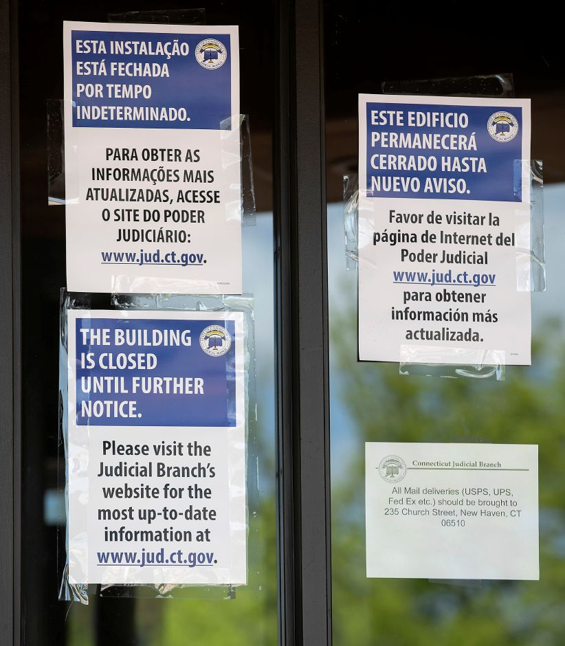 """Building closed"" signs displayed on the front doors of the State of Connecticut Superior Court, 54 W. Main St., Meriden, Fri., May 22, 2020. Dave Zajac, Record-Journal"