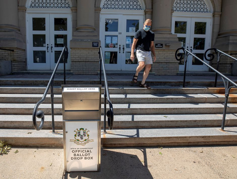 Jon Birney, of Wallingford, walks by an official ballot box in front of Wallingford Town Hall, Mon., Aug. 3, 2020.  Dave Zajac, Record-Journal