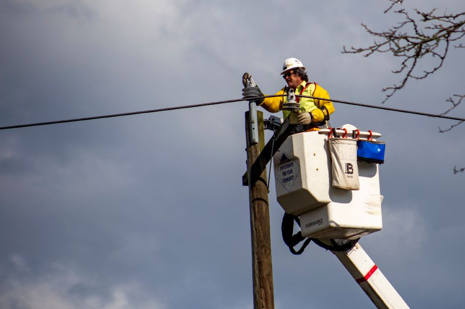 An Eversource employess works on a pole along South Broad Street in Meriden after a storm rumbled through the area Monday May 11, 2020. Several businesses in the area lost power during the storm. | Richie Rathsack, Record-Journal