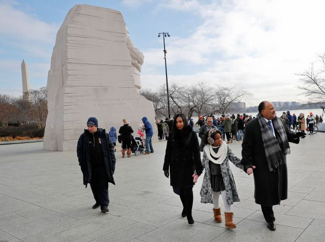 Martin Luther King III, right, holds hands with his wife Arndrea Waters, center, and their daughter Yolanda, 9, during their visit to the Martin Luther King Jr., Memorial on the National Mall in Washington, Monday, Jan. 15, 2018. The son of the late U.S. civil rights activist Martin Luther King Jr., and his family had earlier participated in an event commemorating the life and legacy of his father.(AP Photo/Pablo Martinez Monsivais)