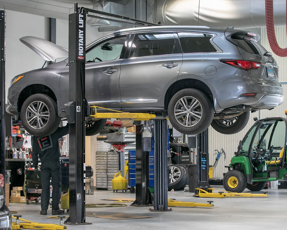 A mechanic works on a vehicle in the service garage at Harte Infiniti, 1076 S. Colony Rd., Wallingford, Tues., Mar. 31, 2020. Dave Zajac, Record-Journal