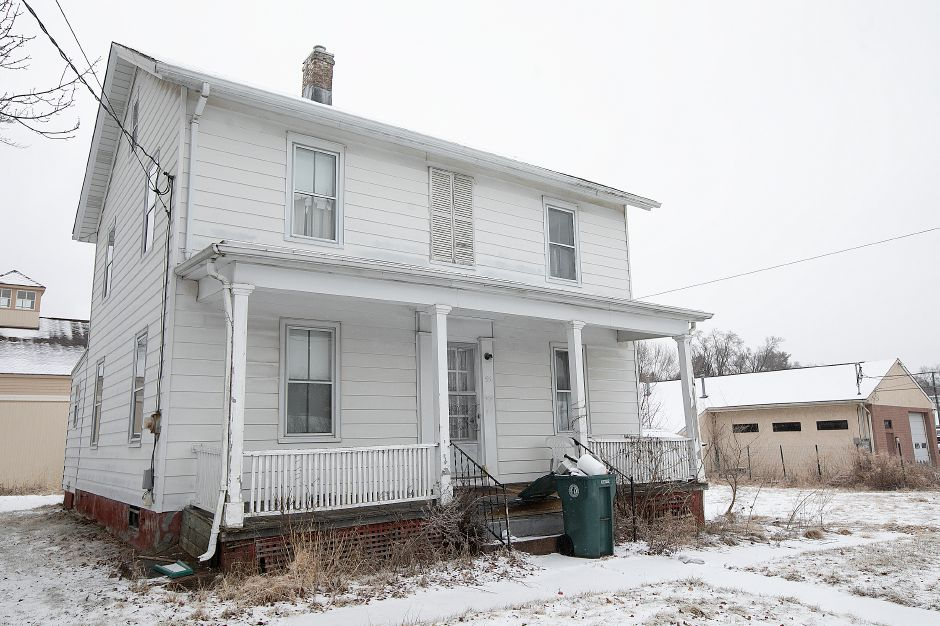 A house at 55 Railroad Ave. across the street from the Farnington Canal Heritage Trail in Cheshire, Mon., Feb. 18, 2019. The Town of Cheshire is considering buying the property for trail parking. Dave Zajac, Record-Journal