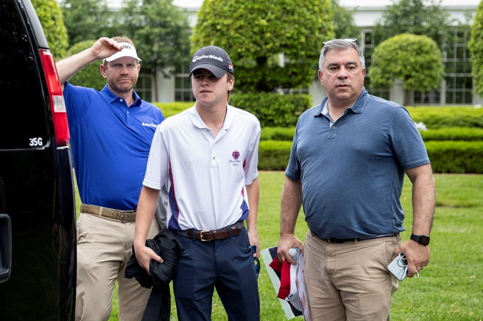 Pro golfer Billy Hurley III, left, and others stand after returning to the White House from his Trump National Golf Club with President Donald Trump, Sunday, May 24, 2020, in Washington. (AP Photo/Alex Brandon)