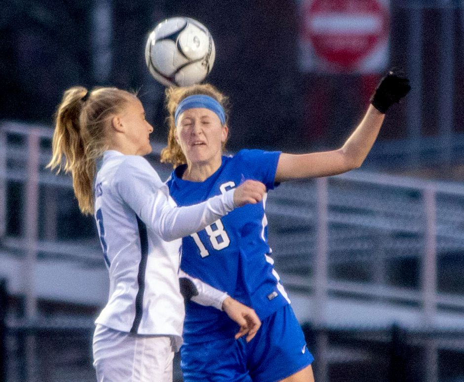 Southington center midfielder Abigail Sowa, seen here battling Glastonbury's Samantha Forrest during the Class LL state championship game, had 12 goals for the Blue Knights and was part of a defense that allowed just six goals in 20 games. Sowa, a junior, was named All-State Class LL. Aaron Flaum, Record-Journal