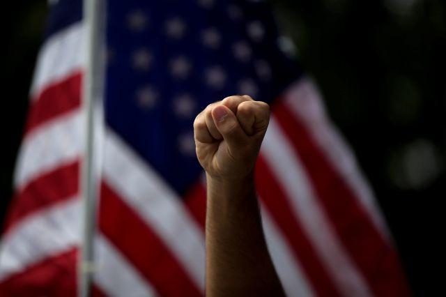 FILE - In this June 1, 2020, file photo, a demonstrator raises his fist during a protest over the death of George Floyd, in Anaheim, Calif. (AP Photo/Jae C. Hong, File)