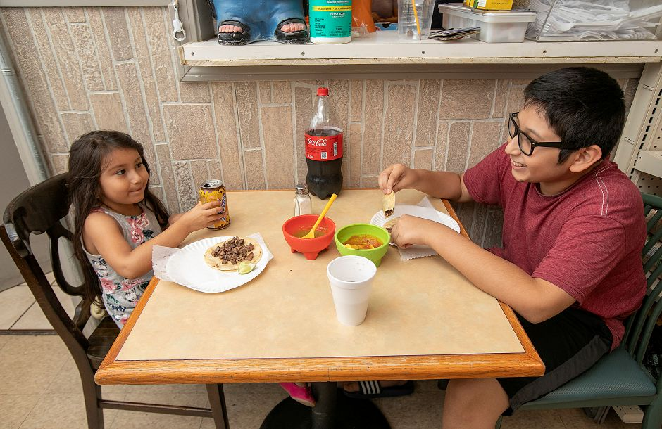 Alison Cervantes, 5, and brother, Oscar, 13, of Meriden, enjoy tacos for lunch at La Poblanita Grocery & Deli, 39 Colony St. in Meriden, Thurs., Aug. 15, 2019. The business is building a dining area in vacant space next door at 41 Colony St. Dave Zajac, Record-Journal