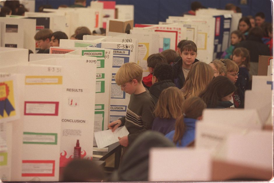 RJ file photo - Some of the more than 500 students visit the Moran Science Fair in Wallingford Feb. 9, 1999. Students raced to each display, seeking answers to questions their teachers assigned them.