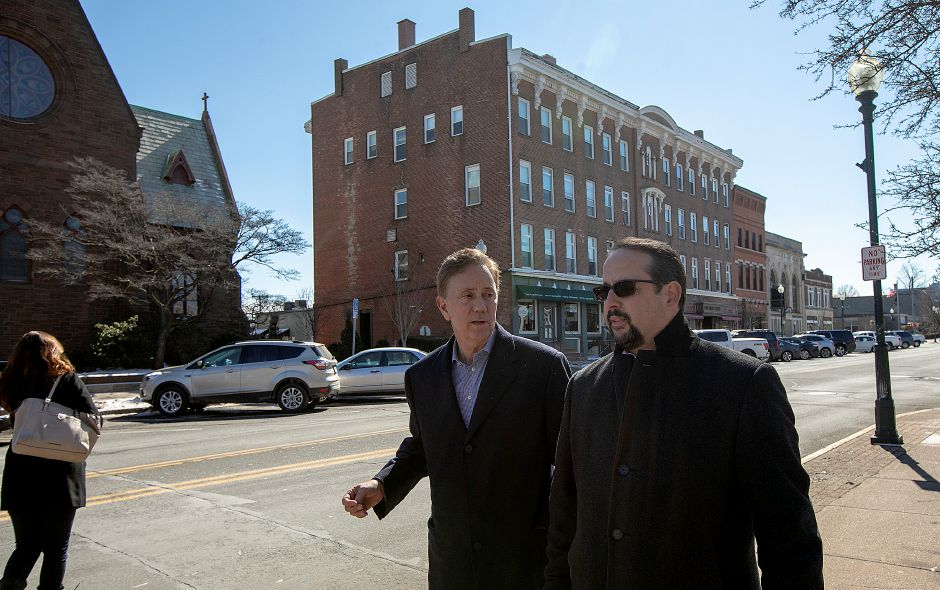 Gov. Ned Lamont, center, talks with Town Councilor Vincent Cervoni during a tour of the uptown area of Wallingford, Thurs., Feb. 28 2019. Dave Zajac, Record-Journal
