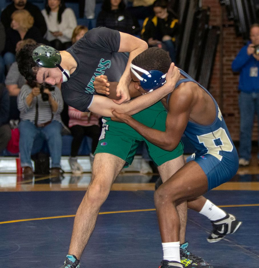 Platt's Isaiah Ross, right, wrestles Maloney's Gehad Saleh in the 126-pound weight class.  Ross earned his 94th career victory with a 20-6 decision.