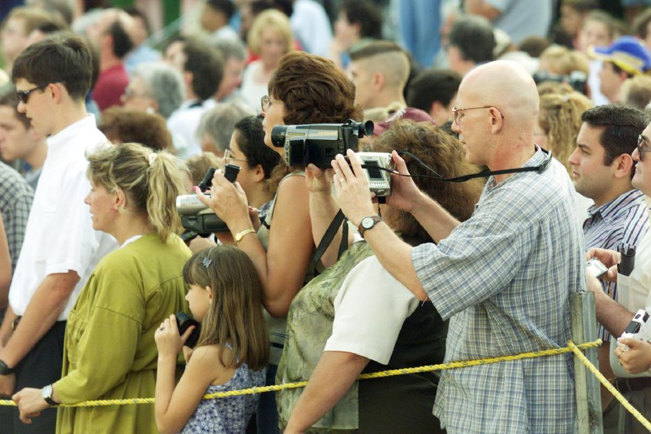Members of the audience video tape the processional at the start of Wilcox Tech graduation Fri., June 16, 2000.