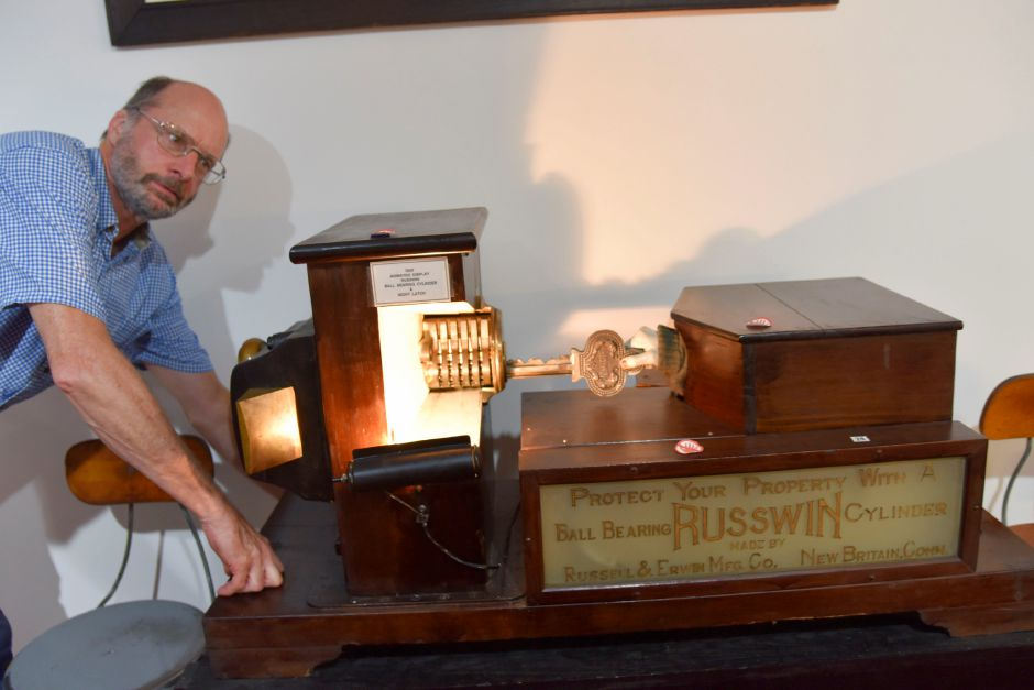 Lock Museum of America volunteer Jerry Milne shows off a lock model on August 23, 2019 at the museum in Terryville. | Bailey Wright, Record-Journal