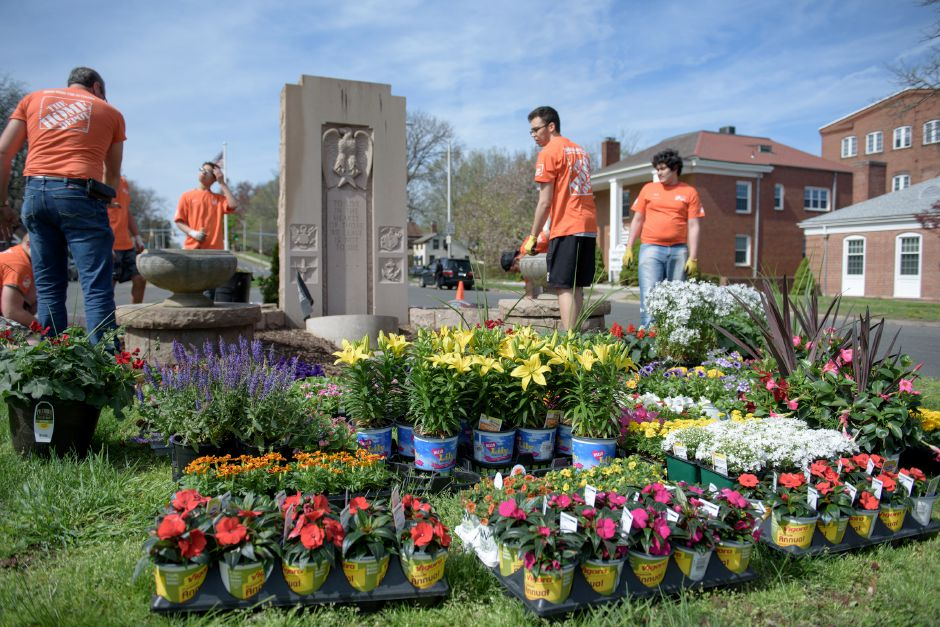 MERIDIAN, CONNECTICUT - 05/05/2018: The Home Depot team works on Veterans Memorial Boulevard. Meriden Mayor Scarpati and the Council of Neighborhoods put on their annual Mayor