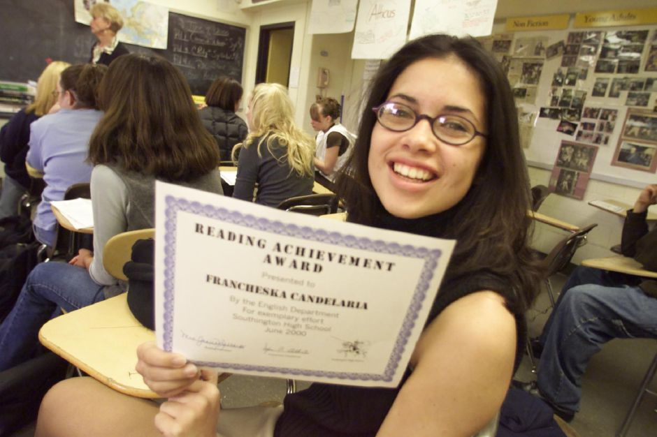 Francheska Candelaria proudly shows off her reading achievement award she just received in her reading class at Southington High School June 7, 2000. Students in the class read nine books this year which is much more than other reading classes at the school in previous years.