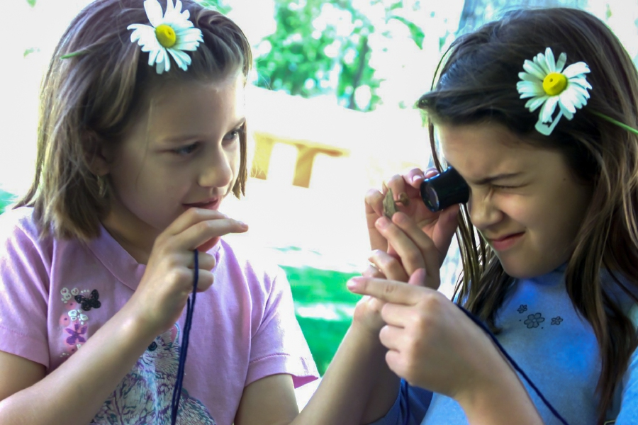 Danielle Poulin, 9, left, and her friend Ashley Ragozzino, 8, both from Meriden, use a lens to magnify a witches cap mushroom that was collected in Meridens Hubbard Park during the BioBlitz event Saturday June 3, 2000. At this display was a table full of local mushrooms.