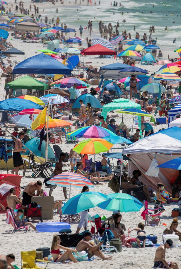 People flocked to Pensacola Beach in Pensacola, Fla. on Saturday. David Grunfeld, The Advocate via AP