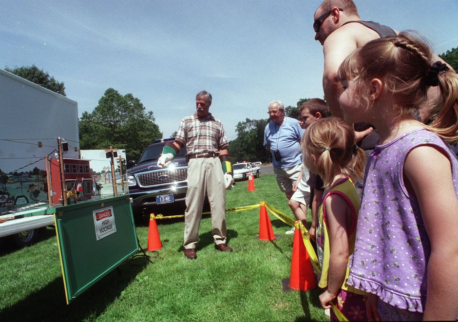 Sisters Shelby (right) and Katelyn Boris of Durham watch the electrical safety demostration by Bob Winoski of North East Utilities at the 2nd Annual Safety Fair held at Hubbard Park in Meriden Saturday afternoon June 24, 2000 .